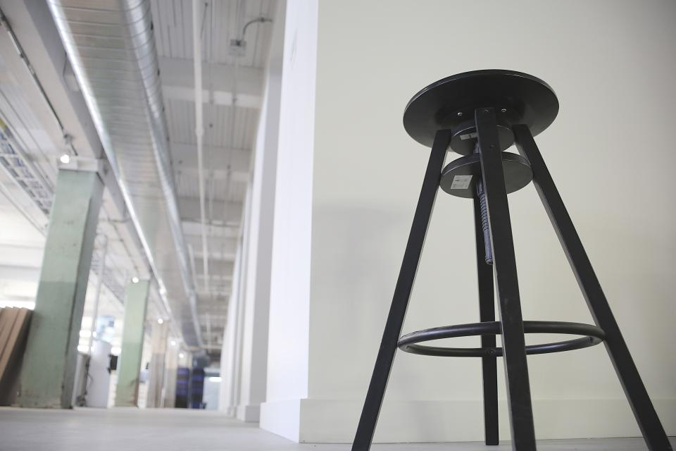stool steat black warehouse industrial pipes vents beams white