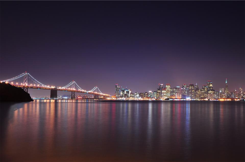 Bay Bridge architecture water reflection ocean sea buildings lights skyline towers high rises city San Francisco USA United States