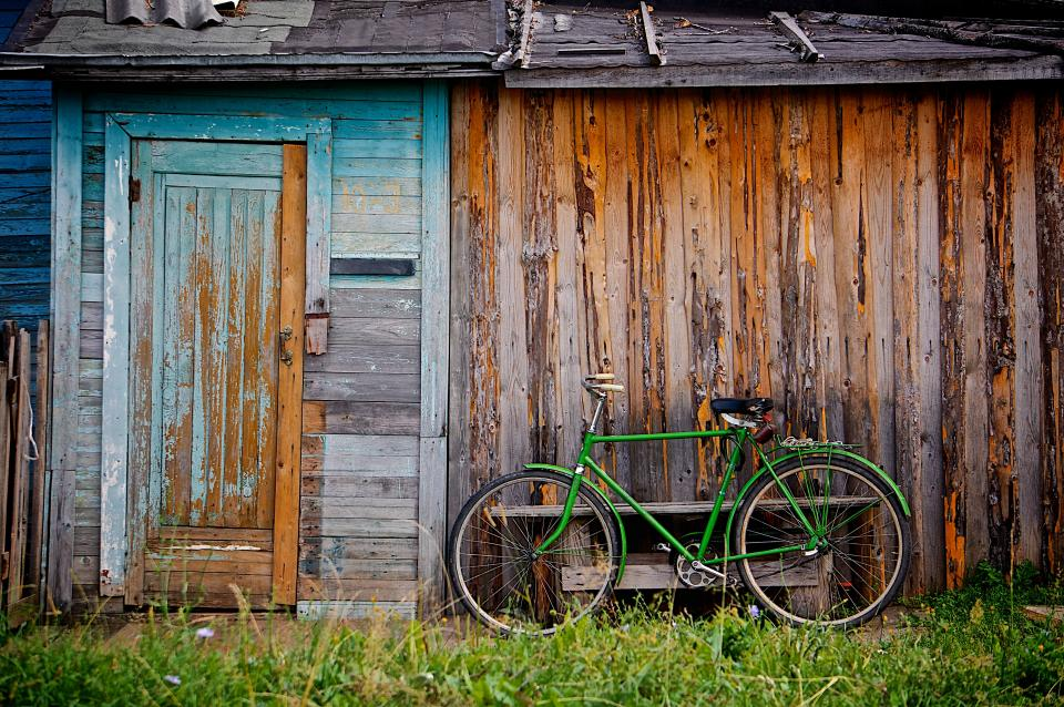 green bike wood shed shack grass rustic