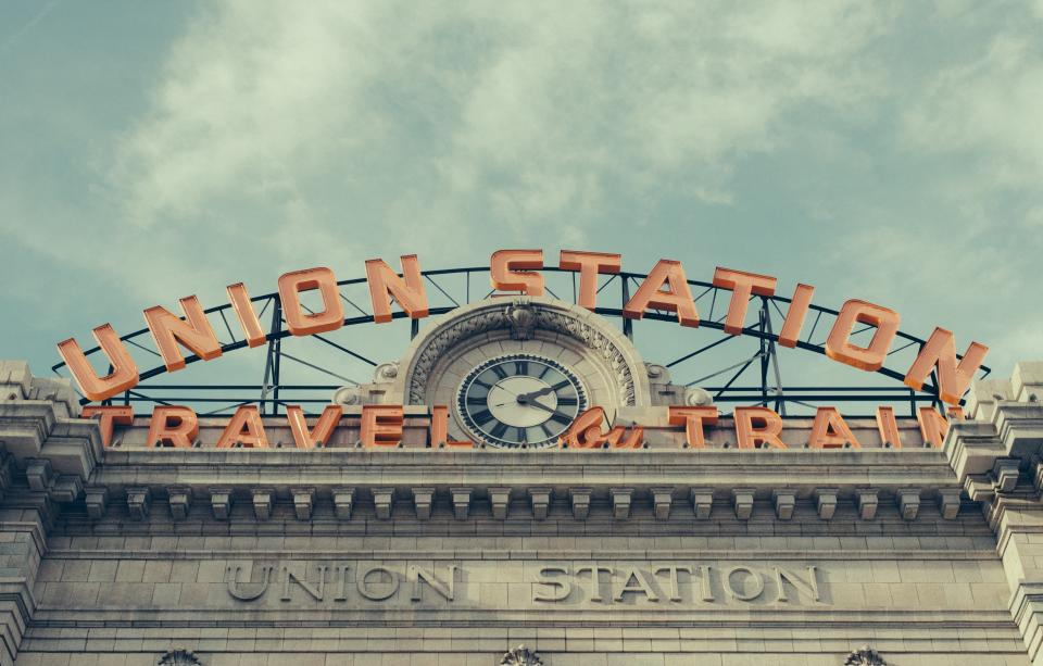 union station travel train arch landmark building sky cloud shopping center