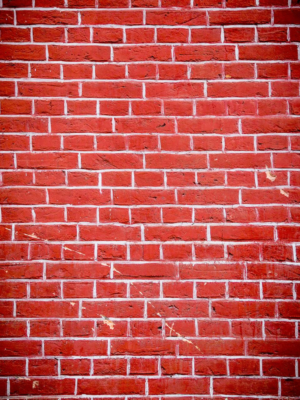 red wall bricks holes cracks