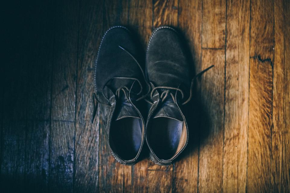 black shoe footwear wooden floor