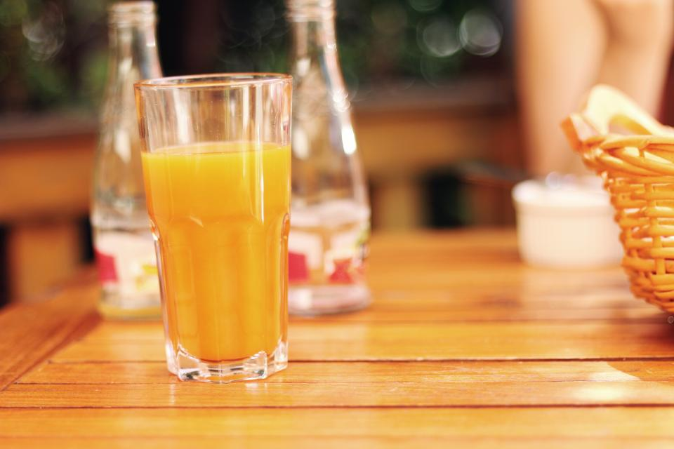 orange juice drink beverage breakfast morning table glass