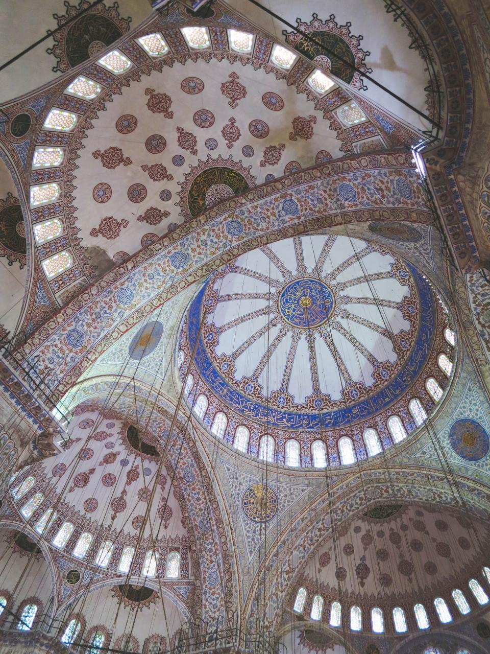 Blue Mosque ceiling Istanbul Turkey architecture glass stained windows ropes