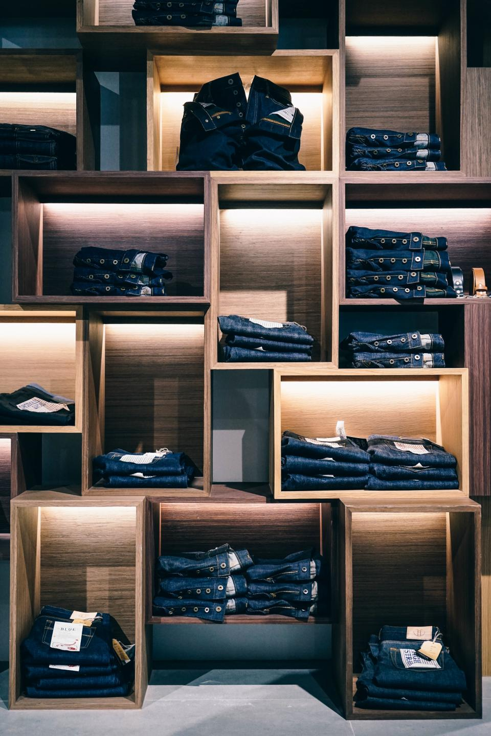 jeans denim clothing fashion store shopping mall wooden shelf