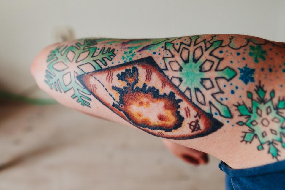 tattoo ink snowflake arm skin