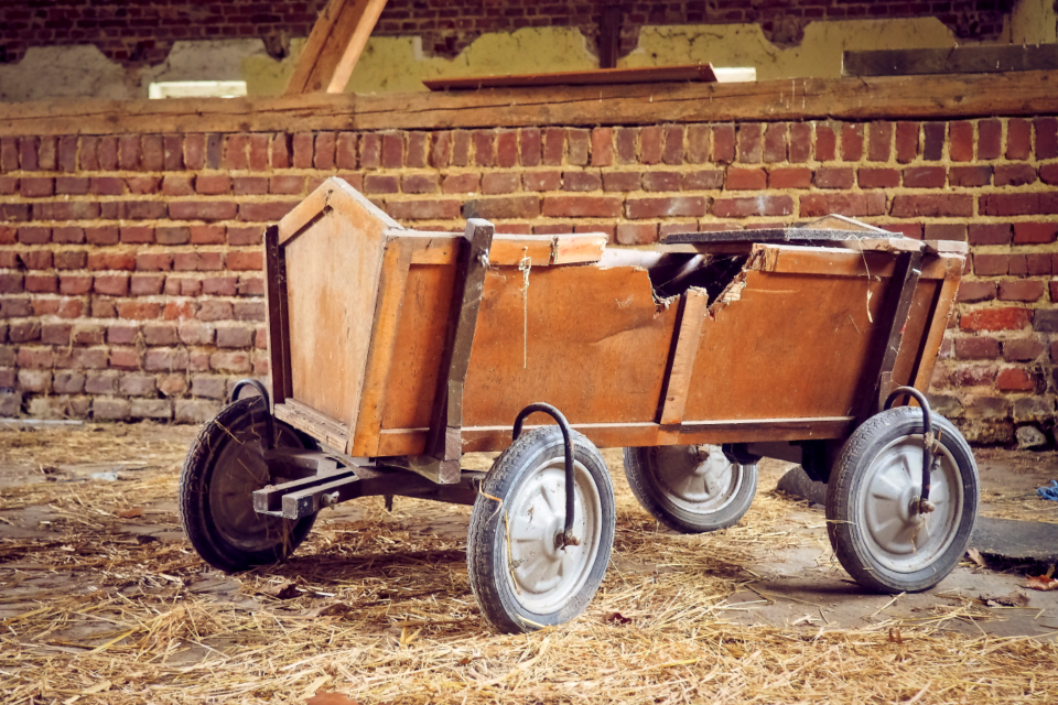 barn stroller wood car lost places broken vintage retro wheels brick wall