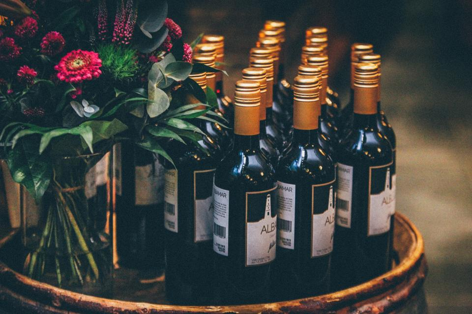 wine bottles wedding flowers bouquet