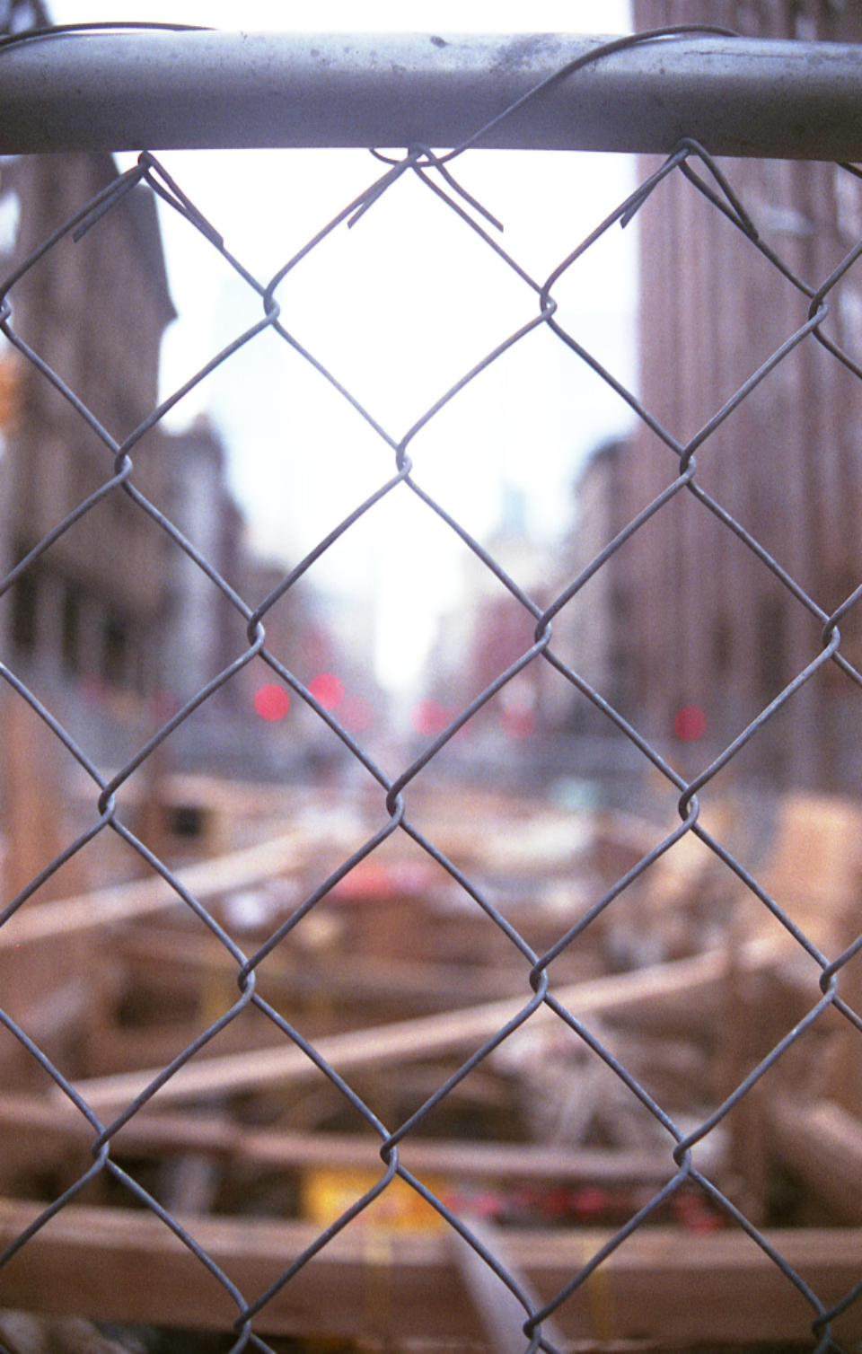 construction site safety area urban mesh chainlink barrier city buildings fence abstract