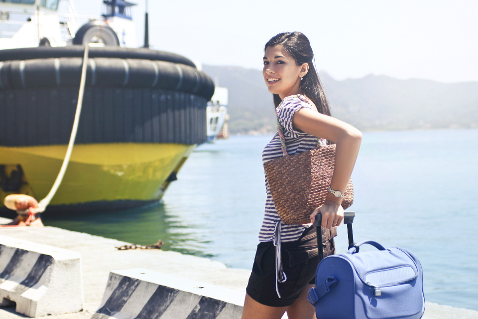 woman luggage travel boat ship sea suitcase vacation holiday ocean water