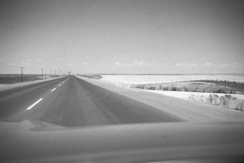 emtpy highway road monochrome horizon landscape travel usa vintage car drive lanes auto film photography america distressed