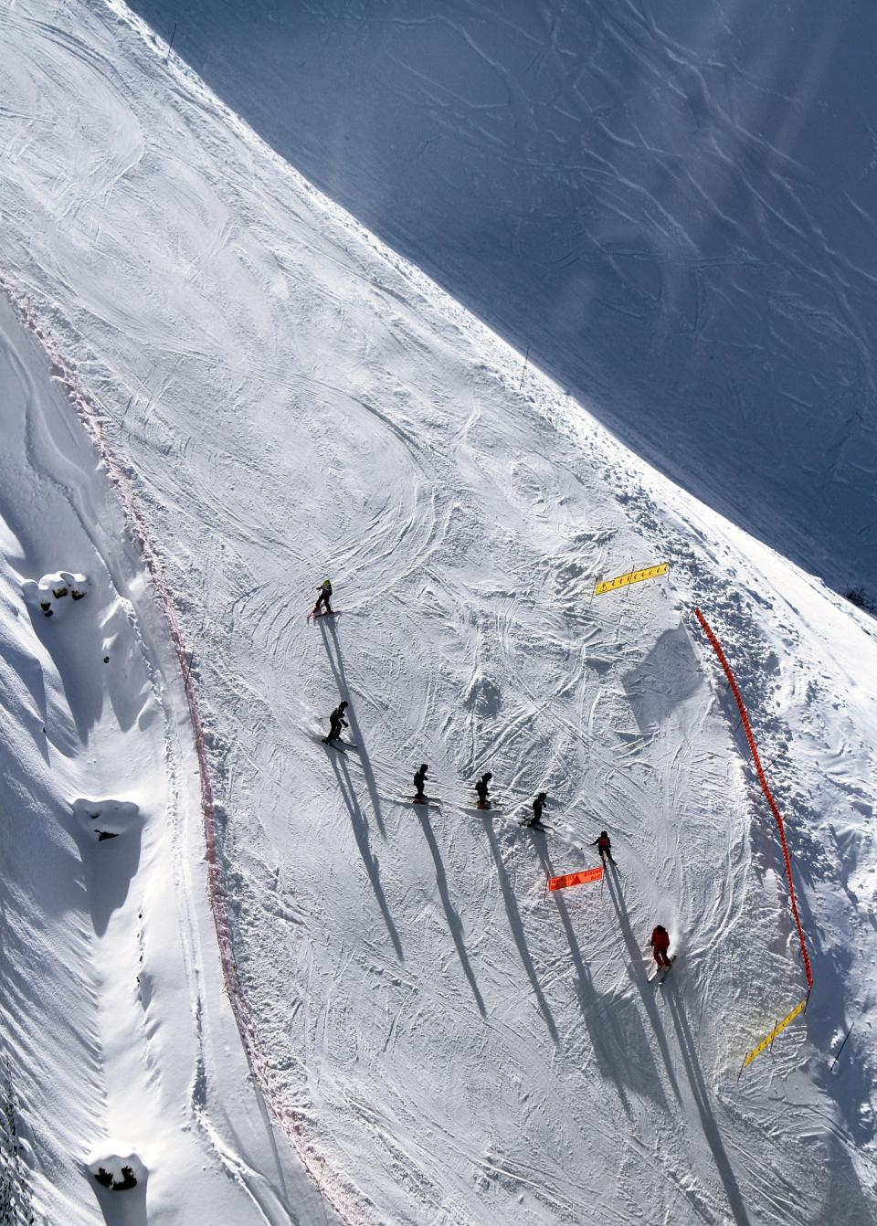 ice skiing skier ski run sunny snow winter people men sport mountain