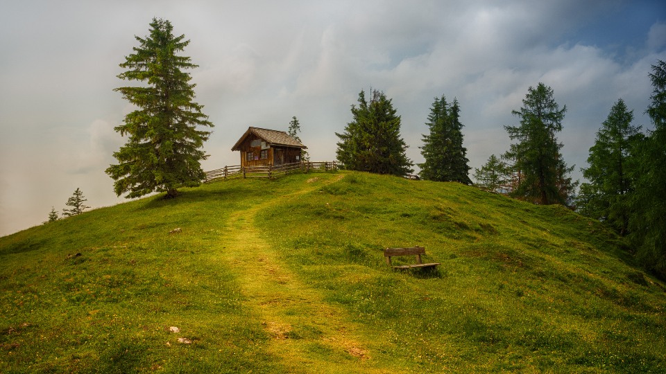 log cabin hill grass green tree winter autumn path nature landscape vista view scenic clouds wood