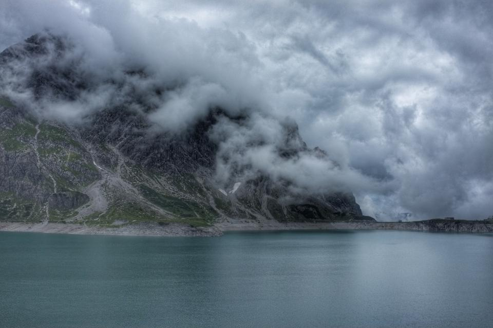 mountain highland cloudy clouds landscape nature sea ocean lake water