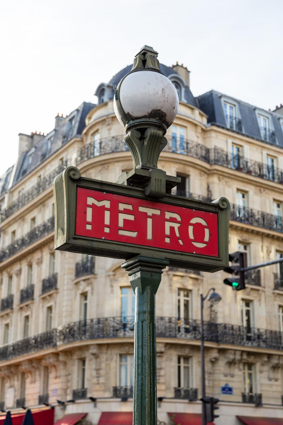 architecture buildings infrastructure pole sign city paris metro lamp street