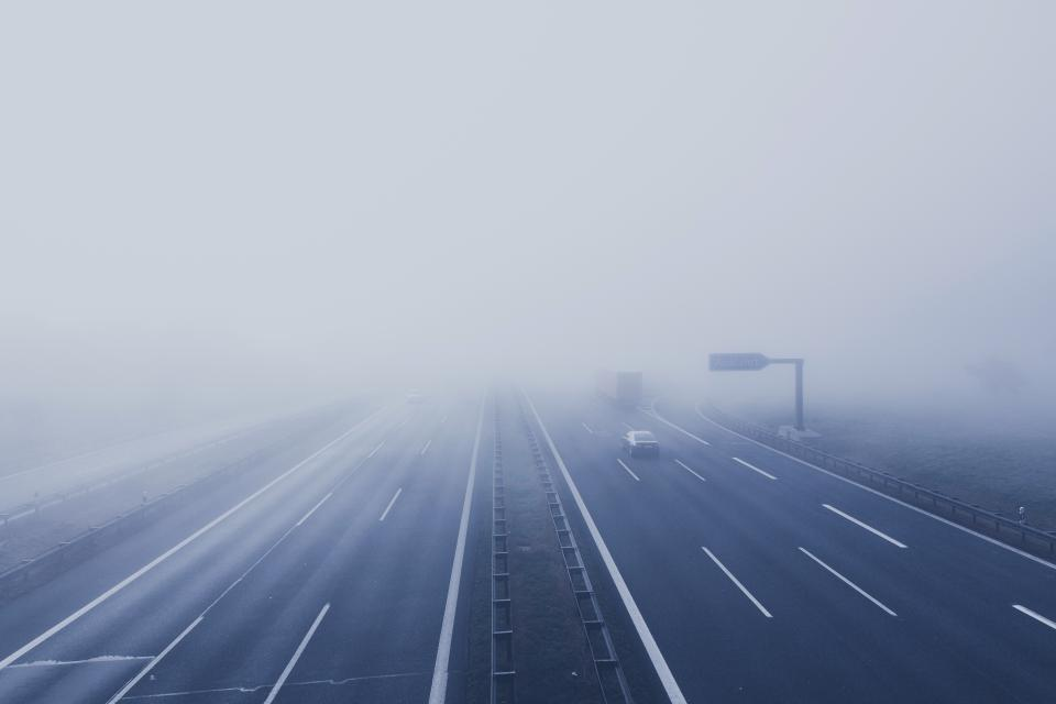 freeway fog vehicle road lane car path expressway trip travel sky dark urban steel