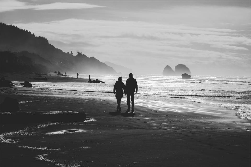 couple love holding hands people romance romantic beach sand shore ocean sea waves black and white