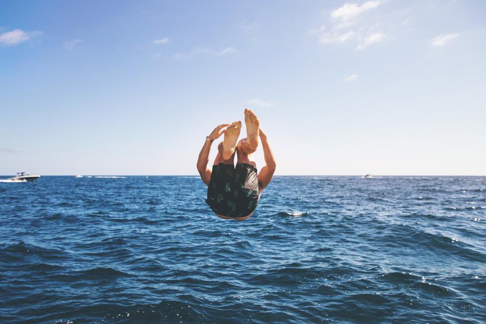 people man diving swimming sea ocean water wave nature blue sky boat sailing