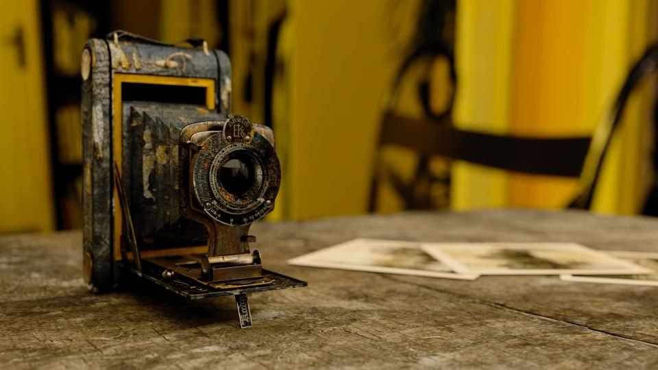 technology camera vintage old decrepit rust photographs desk table wood bokeh still
