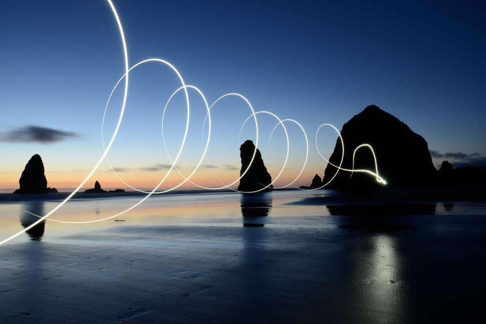nature coast shore beach sand rocks islands light art squiggles swirls water ocean sea reflection long exposure slow shutter bulb photography silhouette