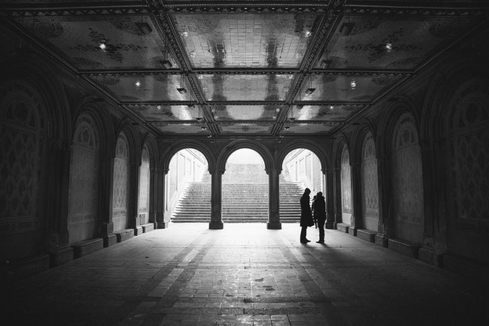 people architecture arches cobblestone black and white