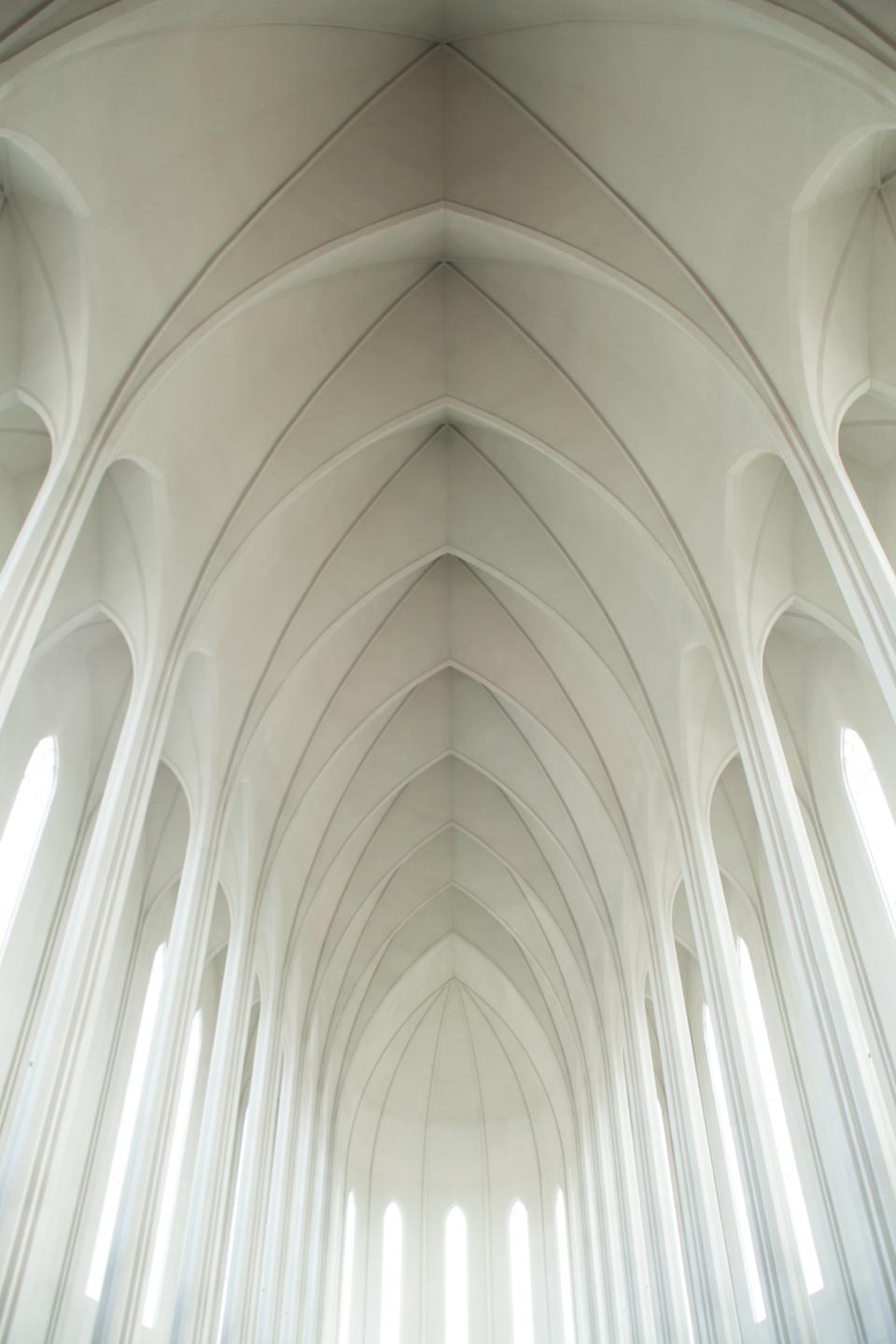 white church arches ceiling sunlight