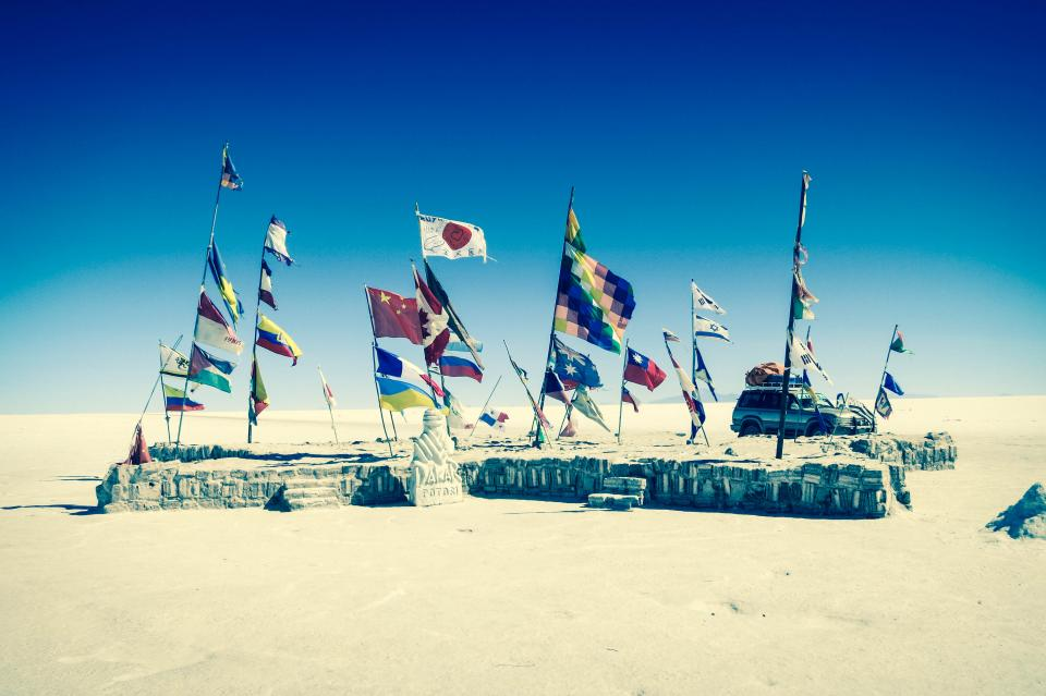 Uyuni Salt Flats Bolivia flags suv truck vehicle