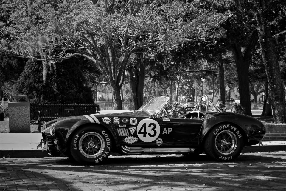 Shelby Cobra race car vintage classic oldschool fast Goodyear tires street cobblestone black and white trees automotive