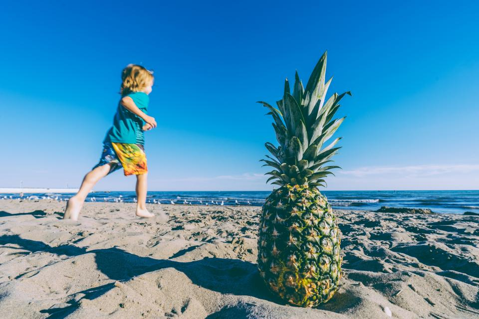 pineapple dessert appetizer fruit juice crop beach ocean sea sand waves people kid child boy