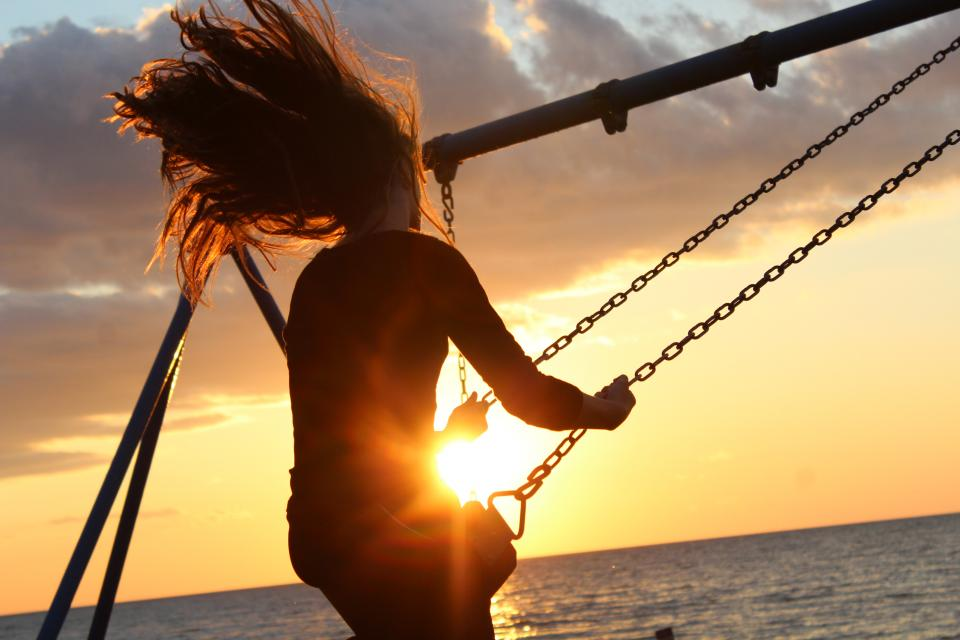 sunlight sunset girl hair people wind seesaw play relax beach sea water nature clouds sky steel