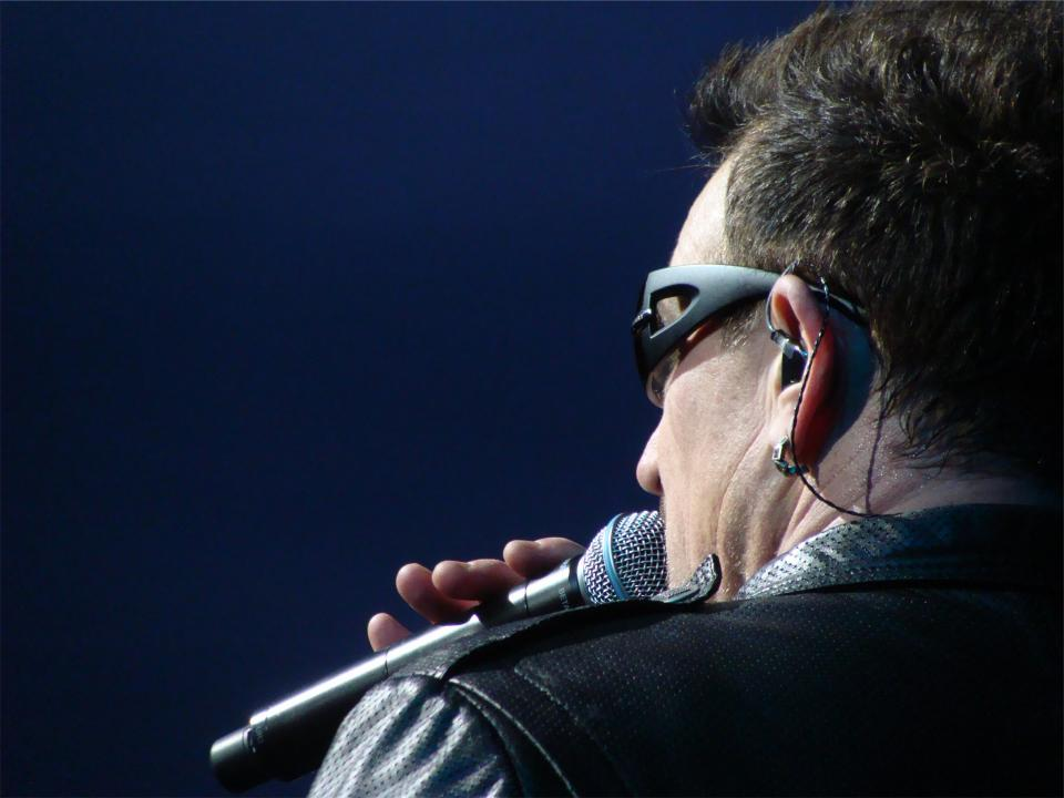 u2 bono singing musician music microphone concert performer earplugs