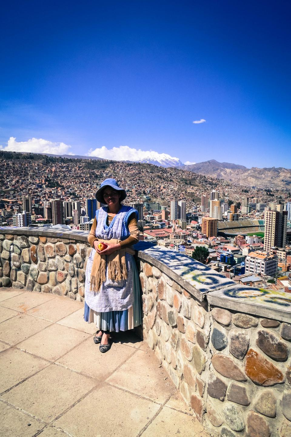 La Paz Bolivia woman lady view buildings city mountains view