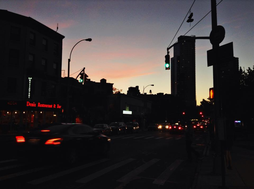 sunset dawn dark city road streets cars traffic lights signs buildings sky
