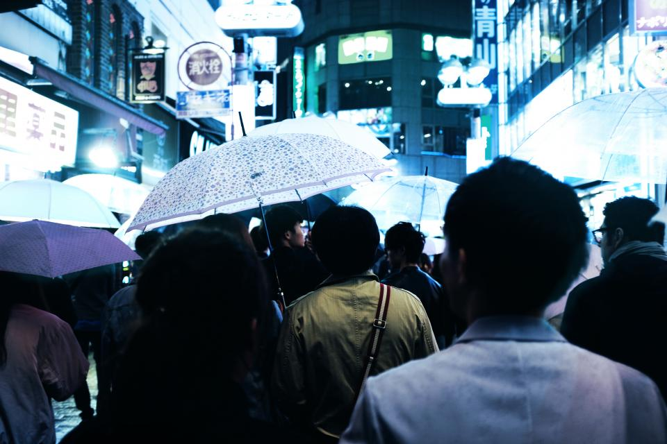 people crowd asian men women rain umbrella buildings city urban