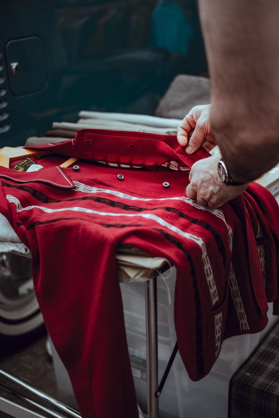 people man hand red sleeves clothing