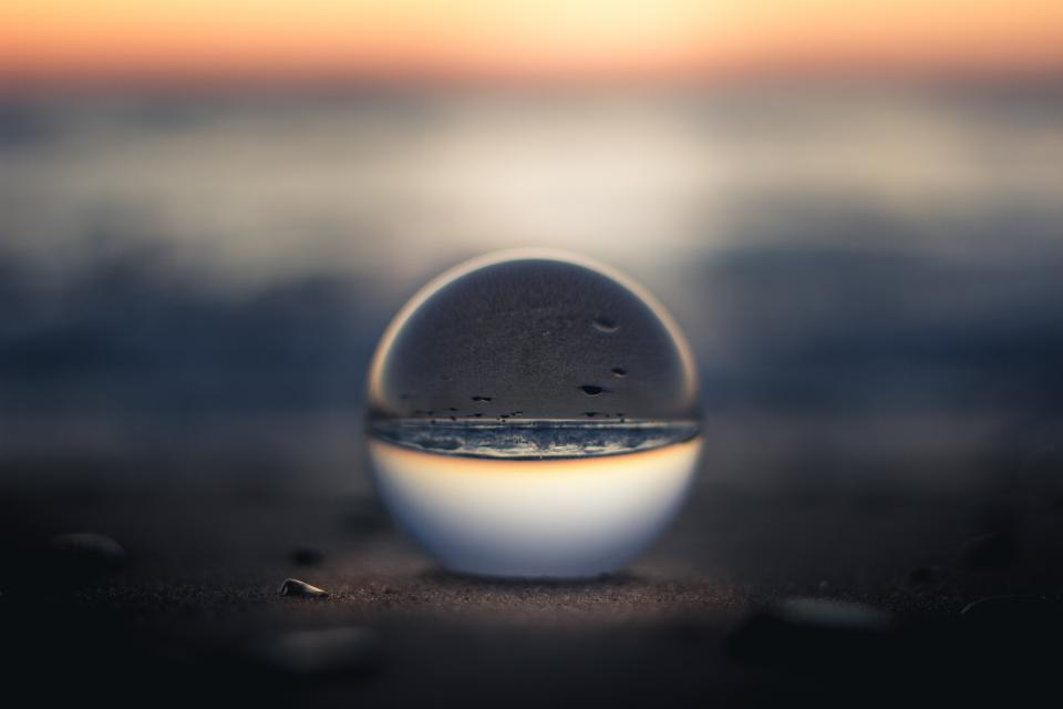 nature water glass sphere sunset horizon beach