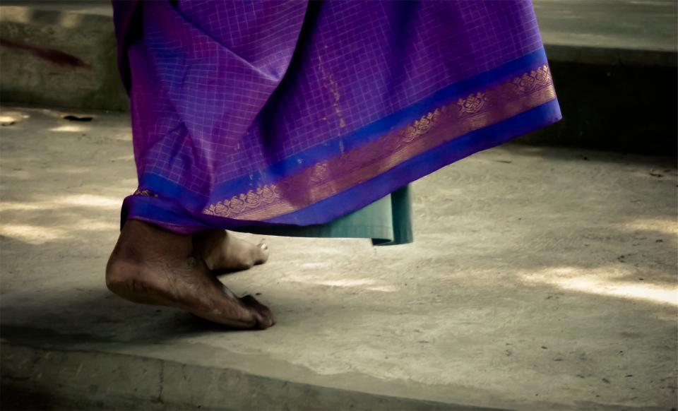 feet purple dress concrete