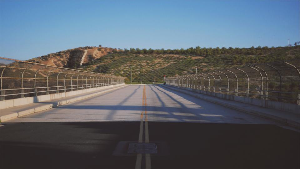 road pavement overpass chainlink fence hills