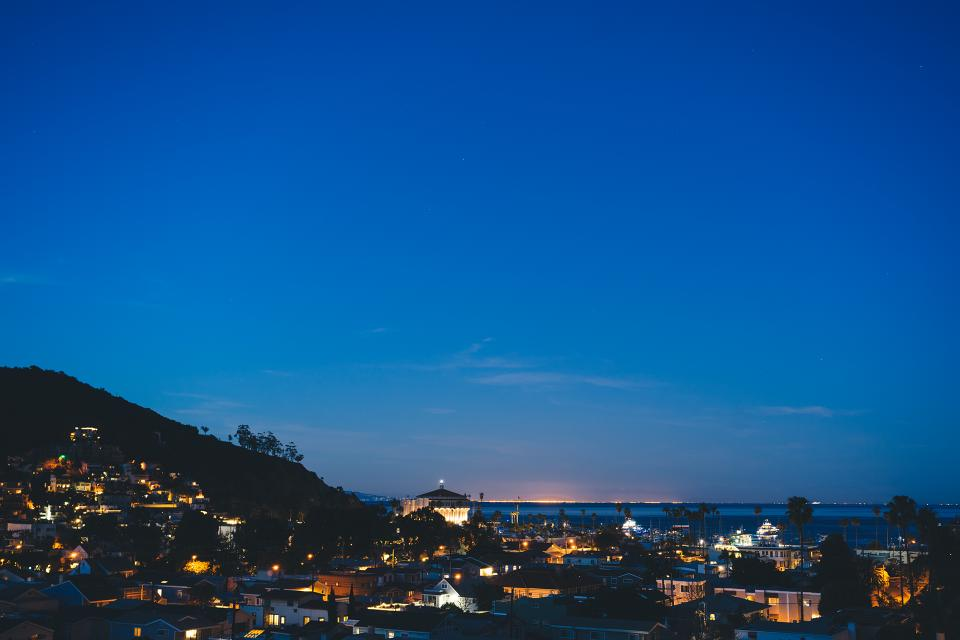 catalina island night evening coast sky lights palm trees buildings sky view town