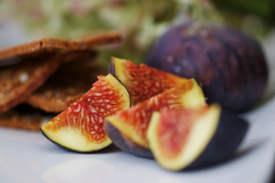 fresh figs fruit cut sliced detail group healthy ingredient organic plate raw close up juicy natural nutrition ripe