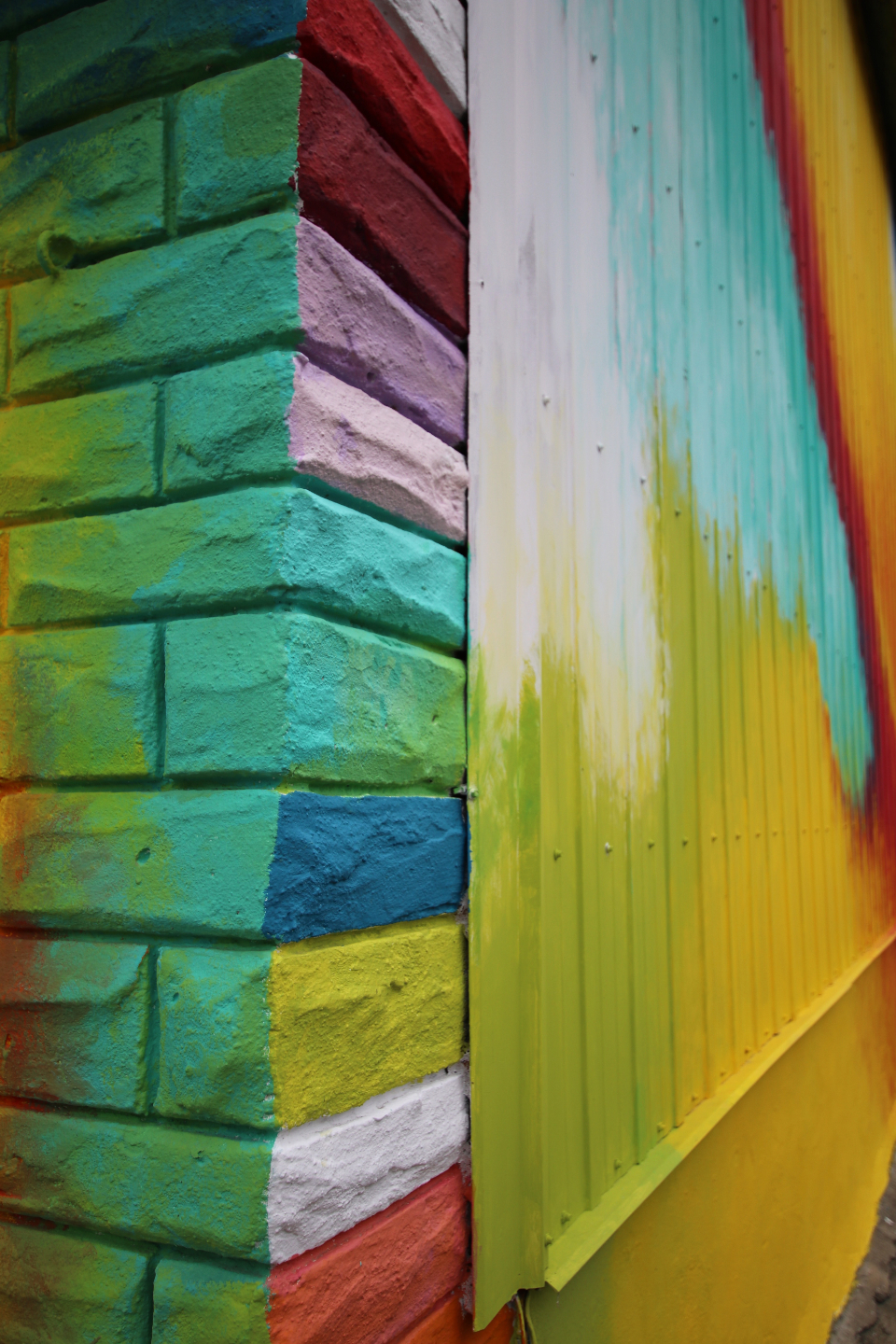 colorful brick wall corner building urban street design art pattern paint exterior colors