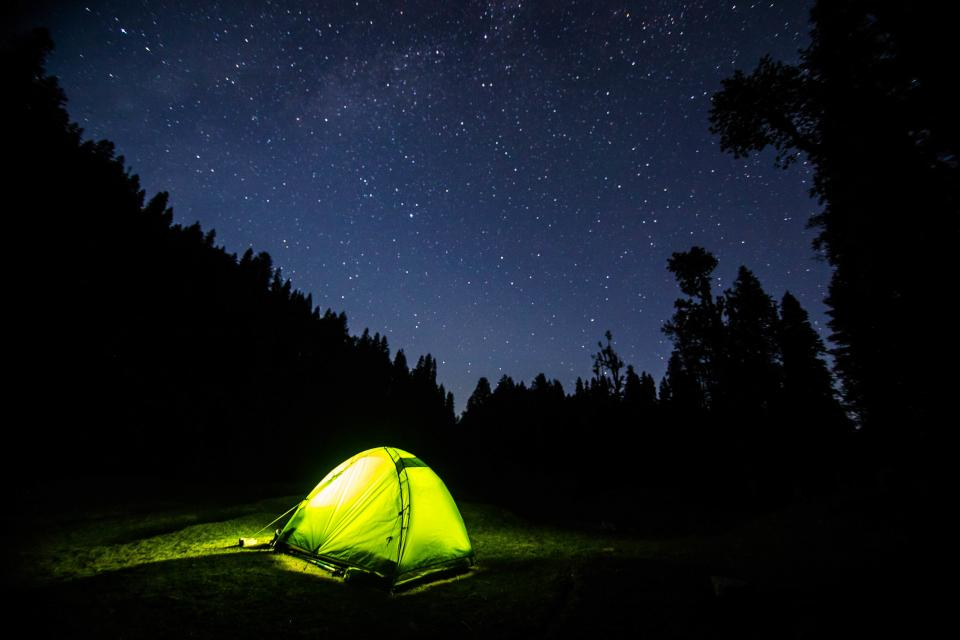 dark night blue sky stars galaxy light tent camping adventure outdoor tree silhouette