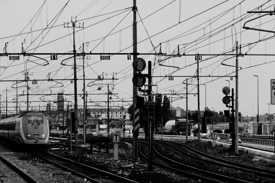 black and white train tranks trains railroad railway power lines signs transportation