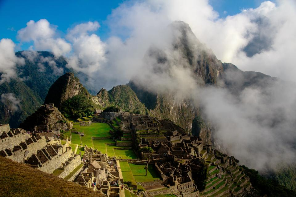 nature landscape mountains slope summit peaks terraces vegetation ancient city rubble ruins inca world heritage ruins