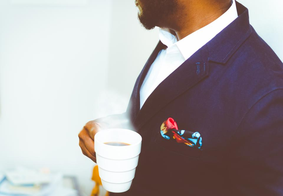 man suit fashion guy gentleman people pocket square cup coffee black african american