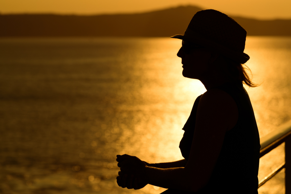 woman sunset water silhouette happy leisure vacation evening sea female trip hat person