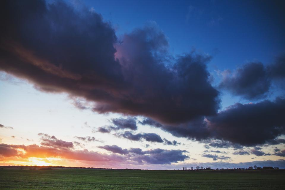 sunset dusk sky clouds field grass landscape nature outdoors rural countryside