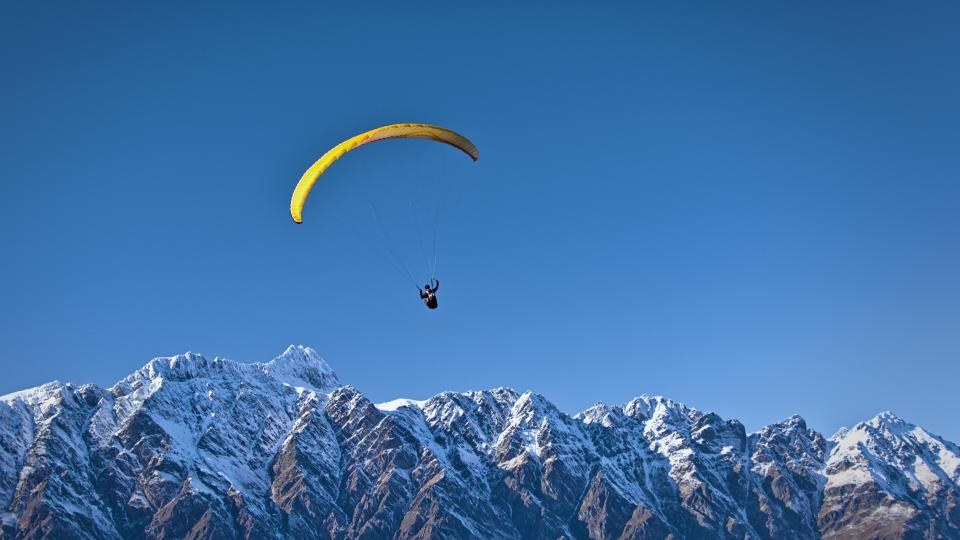 blue sky mountain valley snow winter cold sport paragliding people man
