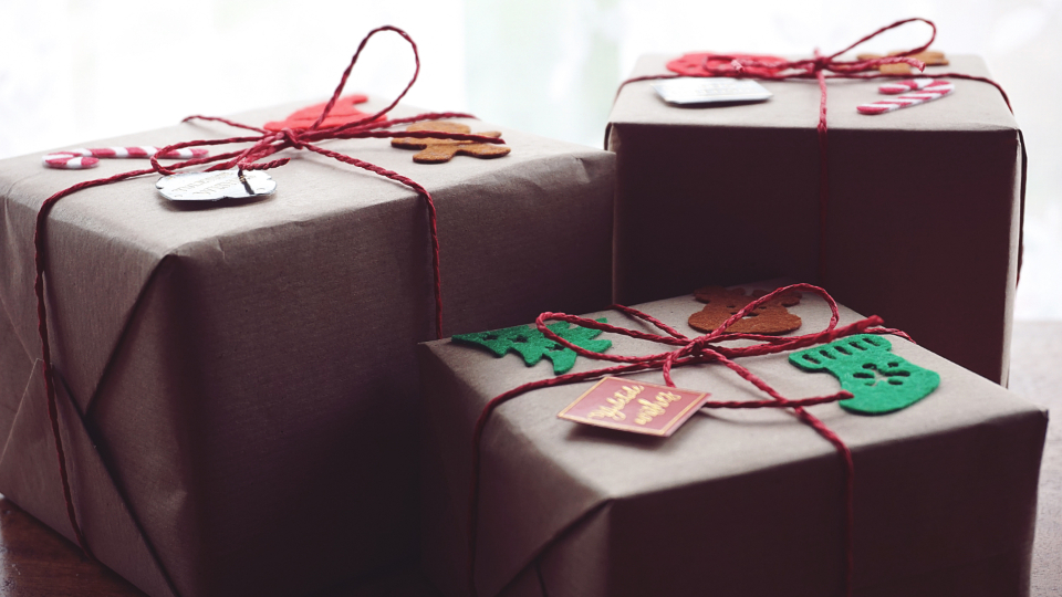 christmas gifts wrapped presents holiday festive merry string tags giving happiness close up celebration objects