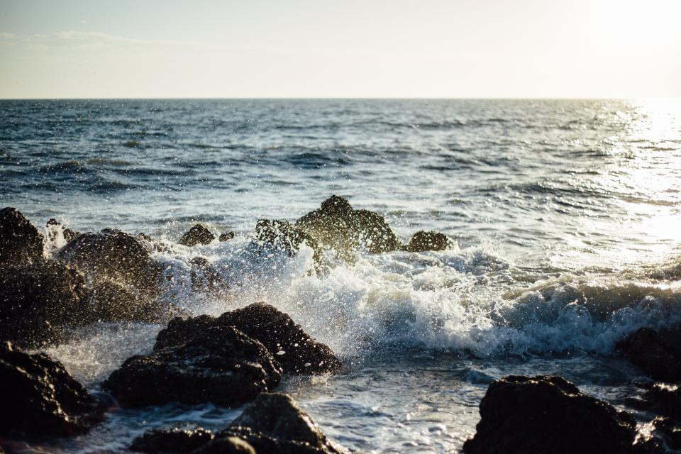 sea ocean water waves nature rocks rocky shore coast horizon sky